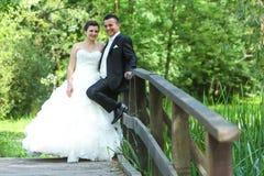 Newlyweds on wooden bridge Stock Photography
