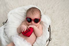 Newobrn Baby Girl with Heart Shaped Sunglasses Royalty Free Stock Photos