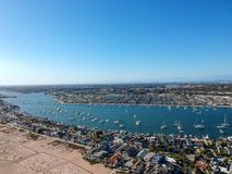 Newport Bay and the Balboa Peninsula. An aerial shot at 330 feet/100 meters looking out over the Newport skyline, the Balboa Peninsula and the Newport Bay full royalty free stock image