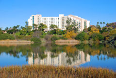 Newport Beach Back Bay and hotel. The image shows the beginnings of the Newport Beach back bay. This important estuary/wetland is surrounded by residential and stock photo