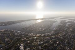 Newport Beach Harbor Afternoon Sun and Fog. Aerial view of afternoon sun and coastal fog over Balboa Bay and Newport Beach Harbor in Orange County, California royalty free stock photo