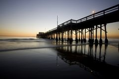 Newport Beach pier. The pier at Newport Beach in Southern California, USA, America at dusk stock image