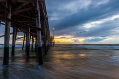 Newport Beach Pier. Sunset before the storm at the Newport Coast Pier. Ocean and waves pushed by fairly heavy winds Stock Photography