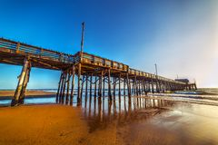 Newport Beach wooden pier at sunset. Los Angeles, California Stock Images