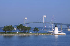 Newport Bridge and Goat Island Lighthouse stock image