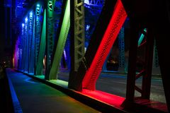 Newport Bridge, Middlesbrough. At night under its new LED light scheme. Colours of the rainbow shining over the steelwork and rivets Royalty Free Stock Photos