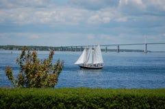 Newport Bridge and Sailing Boat. A sailing boat is sailing by newport bridge, rhode island Royalty Free Stock Image