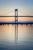 Newport Bridge Sunrise. This is an early morning sunrise under the Newport Bridge seen from the beach at Jamestown, Rhode Island, USA stock image