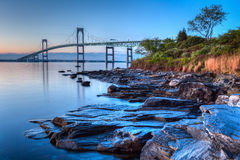 Newport Bridge Sunrise. This is a long exposure HDR of the illuminated Newport bridge from Taylor's Point near Jamestown, Rhode Island, USA. It was taken at stock photo