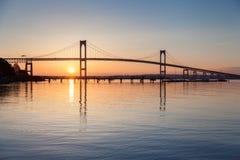 Newport Bridge Sunrise. Morning sunrise under the Newport Bridge seen from Jamestown, Rhode Island, USA stock image