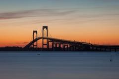 Newport Bridge Sunset. Colorful long exposure, orange sunset view of the Pell Claiborne bridge in Newport, Rhode Island, USA royalty free stock photos