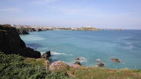Newquay coast view North Cornwall UK in spring with blue sky and sea stock footage