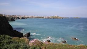 Newquay coastal view North Cornwall UK in spring with blue sky and sea stock video footage