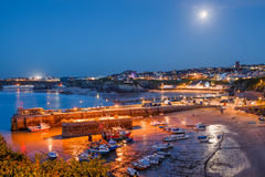 Newquay Cornwall England. Full moon over the harbour and town at Newquay Cornwall England UK Stock Images