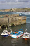 Newquay Harbor - Cornwall - United Kingdom. Fishing boats in Newquay Harbor in Cornwall. United Kingdom. Great Western beach is in the background and is popular Stock Image