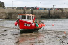 Newquay Harbour Cornwall. Old Newquay Harbour Cornwall Fishing boat awaiting the tide royalty free stock photography