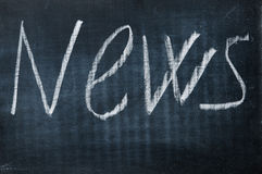 News. Word news written with a chalk on a blackboard Royalty Free Stock Image