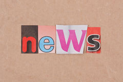 News. Letters sorted on paper background Royalty Free Stock Photo
