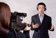 On the News. Reporter reports current and latest events royalty free stock images