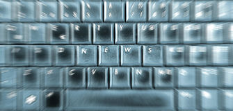 NEWS. Word on laptop keyboard Stock Photos