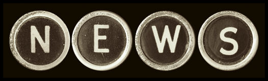 News. Spelt out with vintage typewriter keys.  Sepia tone, black background.  Lots of dust and scratches Royalty Free Stock Photos