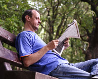 News. Man reading newspaper Stock Photos