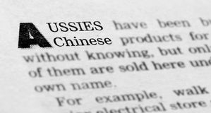 A news article about Australian and Chinese economy. A macro of the words 'Aussies' and 'Chinese' on a news article about economy relations between Australia and Stock Image