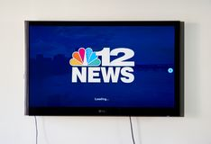 12 News broadcasting app and logo on LG TV. MONTREAL, CANADA - NOVEMBER 15, 2017: 12 News broadcasting app and logo on LG TV screen. WWBT is an NBC-affiliated Stock Photos