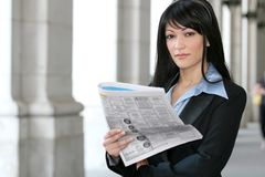 News: Business Woman Reading Newspaper Stock Photo
