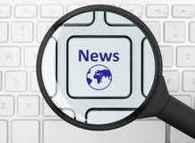 News button under the magnifying glass Royalty Free Stock Photography