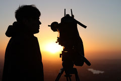 News Cameraman. Television News Cameraman with digitial video camera and tripod shooting sunrise royalty free stock photography