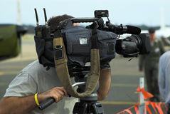 News Cameraman. A news cameraman using his tool of trade stock photo