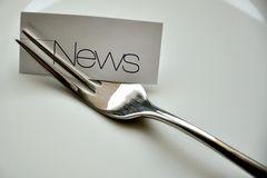 News concept served on a plate  Stock Photos