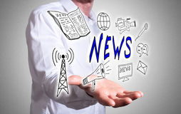 News concept above a human hand Stock Photography