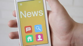 News concept application on the smartphone. Man uses mobile app. stock video footage