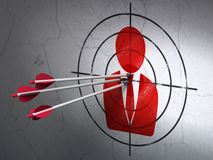 News concept: arrows in Business Man target on wall background. Success news concept: arrows hitting the center of Red Business Man target on wall background, 3d Royalty Free Stock Photo