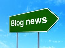News concept: Blog News on road sign background. News concept: Blog News on green road highway sign, clear blue sky background, 3D rendering Royalty Free Stock Photo