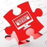 News concept: Breaking News On Screen on puzzle background Royalty Free Stock Photo