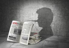 News concept. Fake news. Newspapers cast shadow in form of liar. 3d. Illustration Royalty Free Stock Photos