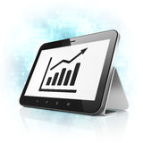 News concept: Growth Graph on tablet pc computer. News concept: black tablet pc computer with Growth Graph icon on display. Modern portable touch pad on Blue Stock Image