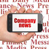 News concept: Hand Holding Smartphone with Company News on display. News concept: Hand Holding Smartphone with red text Company News on display, Tag Cloud royalty free stock photography