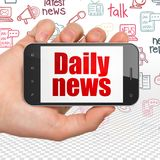 News concept: Hand Holding Smartphone with Daily News on display. News concept: Hand Holding Smartphone with red text Daily News on display, Hand Drawn News stock image