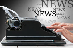 News concept. Hands writing on a vintage typewriter as a communication concept isolated on white Stock Photography
