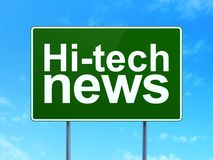 News concept: Hi-tech News on road sign background. News concept: Hi-tech News on green road highway sign, clear blue sky background, 3D rendering Royalty Free Stock Photo
