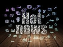 News concept: Hot News in grunge dark room. News concept: Glowing text Hot News,  Hand Drawn News Icons in grunge dark room with Wooden Floor, black background Stock Photography