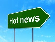 News concept: Hot News on road sign background Royalty Free Stock Photos