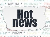 News concept: Hot News on Torn Paper background. News concept: Painted black text Hot News on Torn Paper background with  Tag Cloud Stock Photos