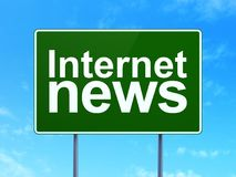 News concept: Internet News on road sign background Royalty Free Stock Images