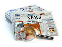 News concept. Newspapers and magnifying glass isolated on white. Royalty Free Stock Images