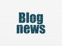 News concept: Blog News on wall background. News concept: Painted blue text Blog News on White Brick wall background Stock Photos